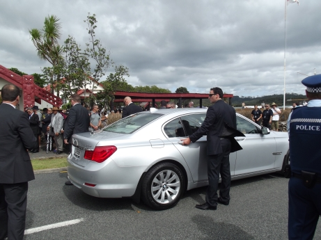 John Key's car arrives. SAS Body guards ready to die for their master.